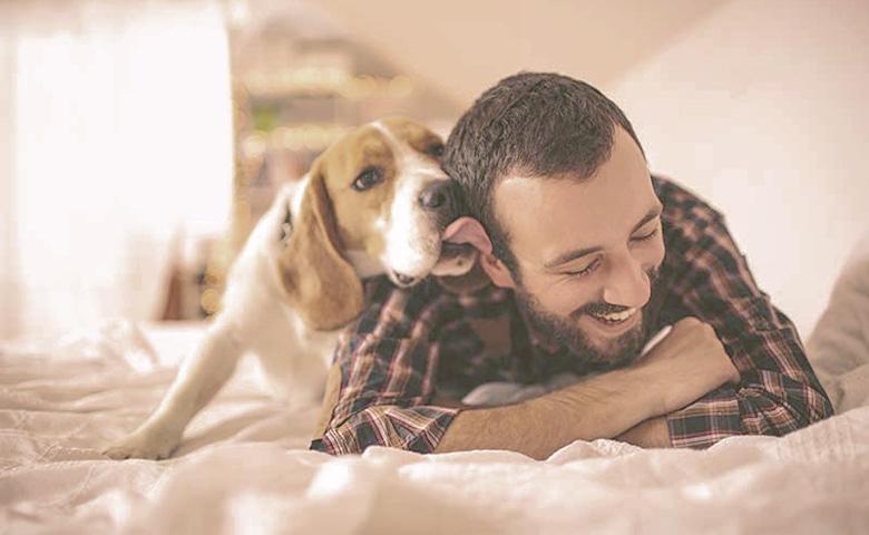 dog licking men face