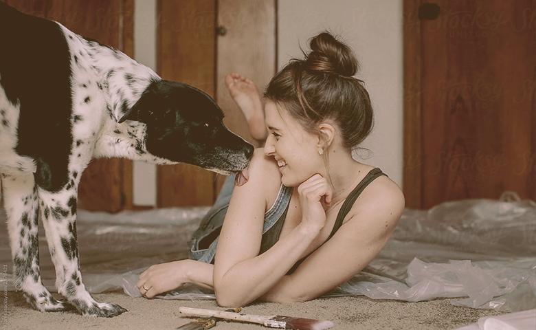 dog licking women shoulder